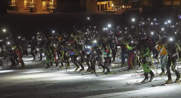 At exactly midnight on Friday, participants in the Grand Traverse ski mountaineering race between Crested Butte and Aspen start the 37.25-mile race across the West Elk Mountains.