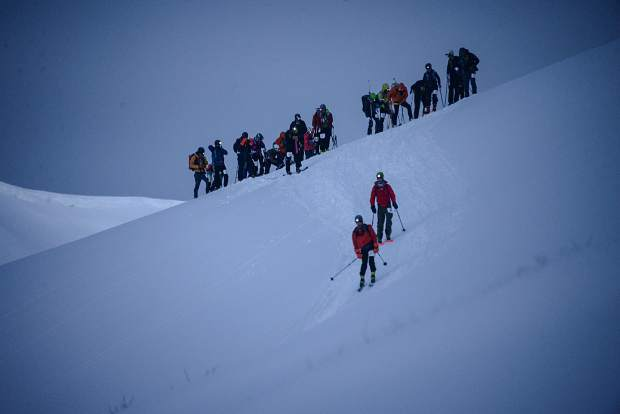 Grand Traverse ski mountaineering racers cross Star Pass near Crystal Peak in the Elk Mountain Range Saturday morning.
