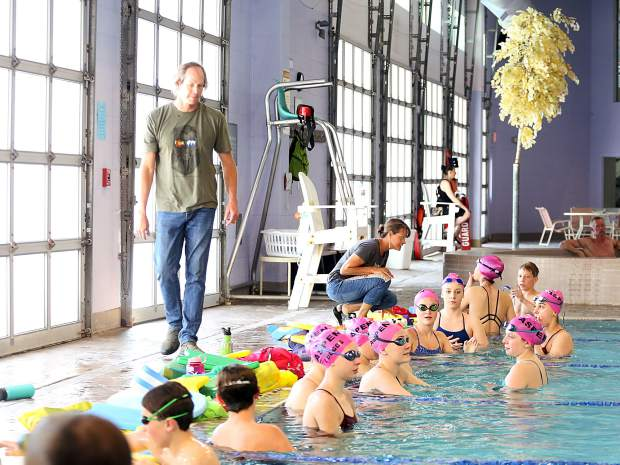 Aspen Swim Club coach Tom Jager guides practice on April 5, 2019, at the Aspen Recreation Center pool. (Photo by Austin Colbert/The Aspen Times).