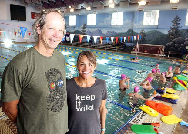 Aspen Swim Club coaches Tom Jager, left, and Becky Jager pose for a photo during practice on April 5, 2019, at the Aspen Recreation Center pool. (Photo by Austin Colbert/The Aspen Times).