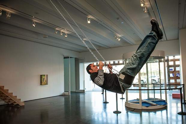 Richard Morales swings at the Aspen Art Museum in November on artist EJ Hill's