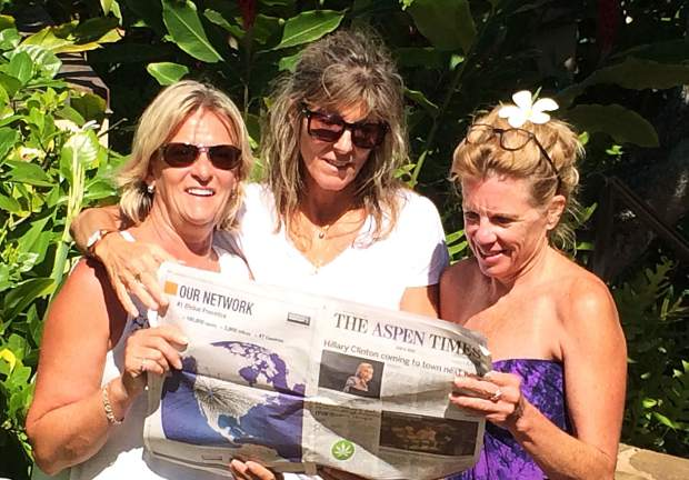 Aspen High School graduates Diana Burton, Danielle Tache and Margie Throm show their continuing education by reading The Aspen Times in Princeville Resort, Kauai, Hawaii.