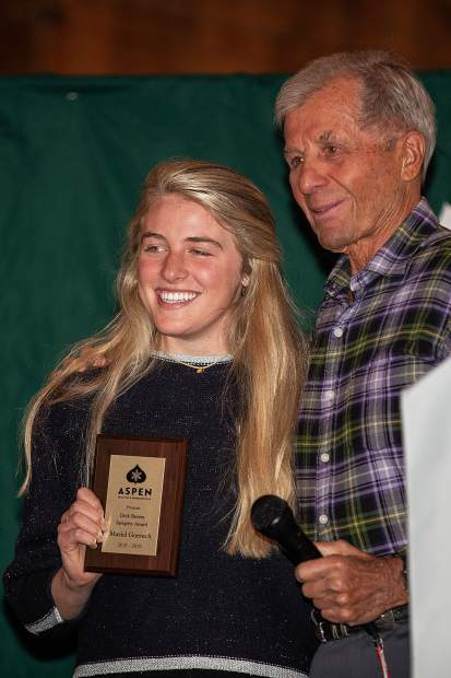 Mariel Gorsuch poses for a photo with Dick Butera after receiving the Dick Butera Integrity award at the AVSC banquet Friday night at Bumps.