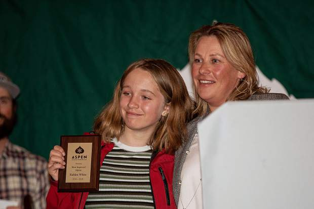 Kahlen White poses for a photo with alpine program director Alice Black after receiving the Most Improved award at the AVSC banquet Friday night at Bumps.