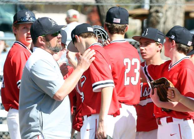 Aspen High School baseball coach Brian Bradford talks to the players between innings against Steamboat Springs on Monday, April 8, 2019, at Crawford Field in El Jebel. (Photo by Austin Colbert/The Aspen Times).