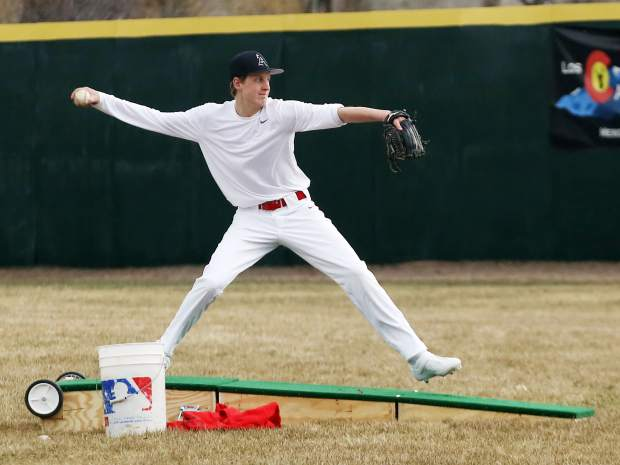 Aspen High School pitcher Jon Haisfield throws during baseball practice on Tuesday, April 2, 2019, at Crawford Field in El Jebel. (Photo by Austin Colbert/The Aspen Times).