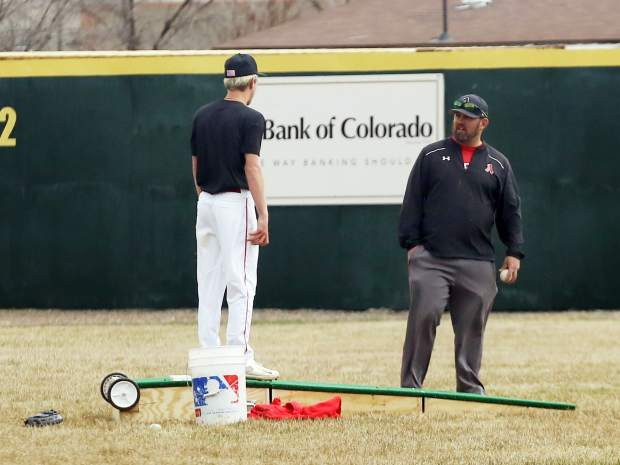 Aspen High School baseball coach Brian Bradford, right, talks with pitcher Jack Pevny during practice on Tuesday, April 2, 2019, at Crawford Field in El Jebel. (Photo by Austin Colbert/The Aspen Times).