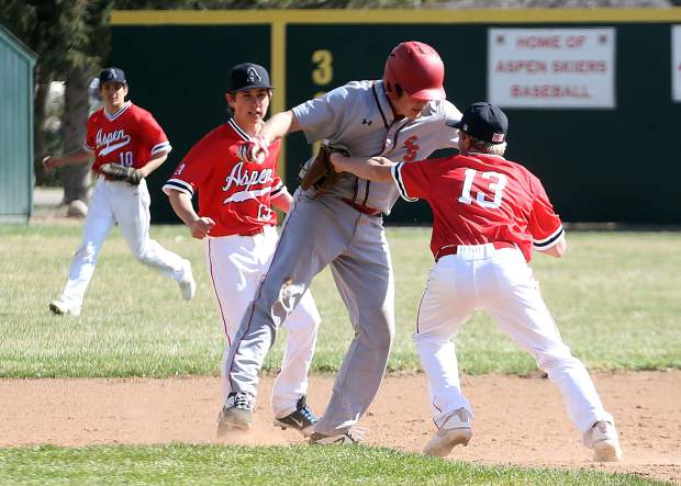 Aspen High School junior Jack Pevny, No. 13, makes a tag on a Steamboat Springs base runner in a game Monday, April 8, 2019, at Crawford Field in El Jebel. (Photo by Austin Colbert/The Aspen Times).
