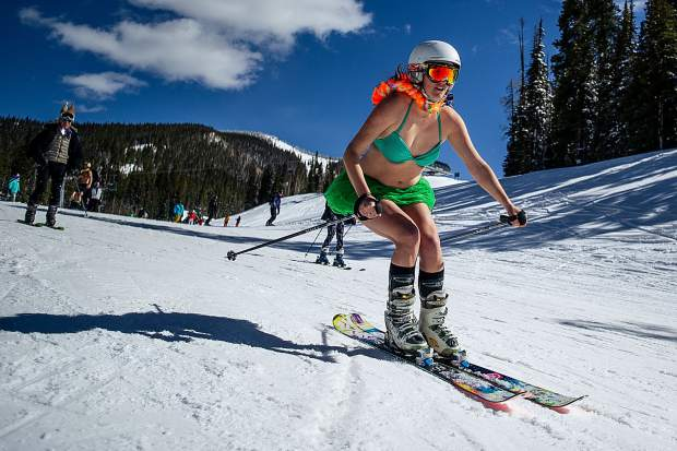 A participant of the swimsuit ski down at Snowmass for closing day.