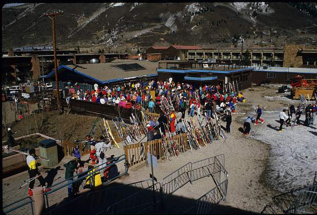 A crowd at the base of Aspen Mountain on its closing day in April of 1988. Construction of The Little Nell began after that ski season .