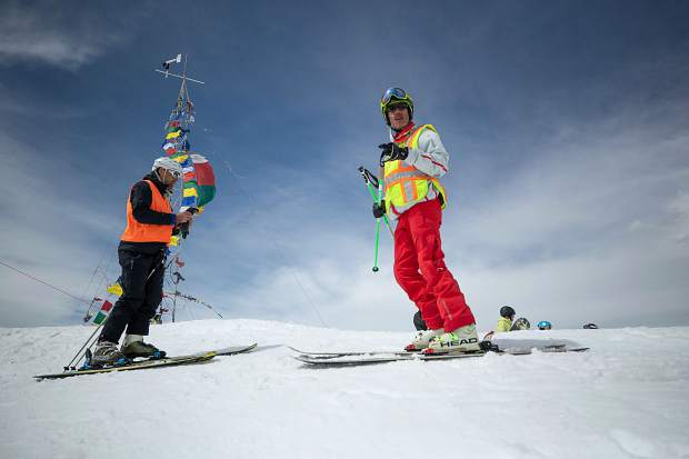 Blind skier and adventurer Erik Weihenmayer prepares to descend Highland Bowl with blind skier guide Rob Leavitt assisting with direction on April 9.