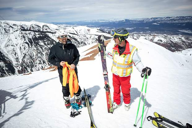 Blind skier and adventurer Erik Weihenmayer at the summit of Highland Bowl with blind skier guide Rob Leavitt on April 9.