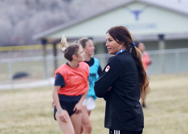 Basalt High School girls soccer coach Kate McBride looks on during practice on Tuesday, April 2, 2019, in Basalt. (Photo by Austin Colbert/The Aspen Times).