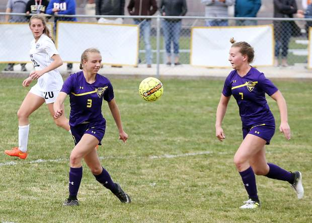 Basalt High School juniors Taylor Glen, left, and Sasha Brucker eye a loose ball in the girls soccer game against Vail Mountain on Tuesday, April 9, 2019, in Basalt. (Photo by Austin Colbert/The Aspen Times)