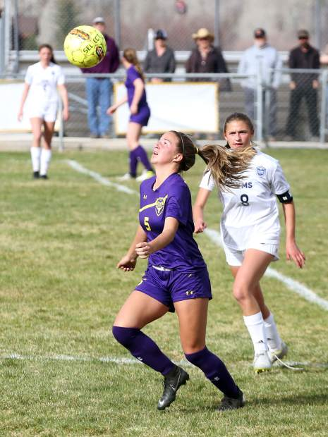 Basalt High School sophomore Delaney Card eyes an airborne ball in the girls soccer game against Vail Mountain on Tuesday, April 9, 2019, in Basalt. (Photo by Austin Colbert/The Aspen Times)