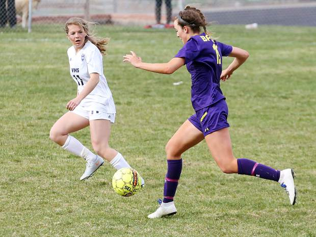 Basalt High School senior Stella Scott, right, goes on the attack in the girls soccer game against Vail Mountain on Tuesday, April 9, 2019, in Basalt. (Photo by Austin Colbert/The Aspen Times)