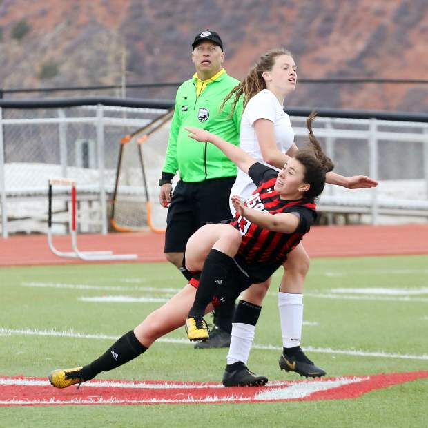 Aspen High School senior Clara Maxwell gets knocked over by a hard hit in the girls soccer game against Coal Ridge on Tuesday, April 16, 2019, on the AHS turf. The Skiers rolled to a 7-0 win to remain perfect since spring break. (photo by Austin Colbert/The Aspen Times).