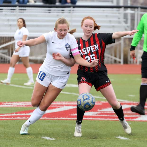 Aspen High School sophomore Kelley Francis, right, battles for the ball with Coal Ridge's Amanda McPherson in the girls soccer game on Tuesday, April 16, 2019, on the AHS turf. The Skiers rolled to a 7-0 win to remain perfect since spring break. (photo by Austin Colbert/The Aspen Times).