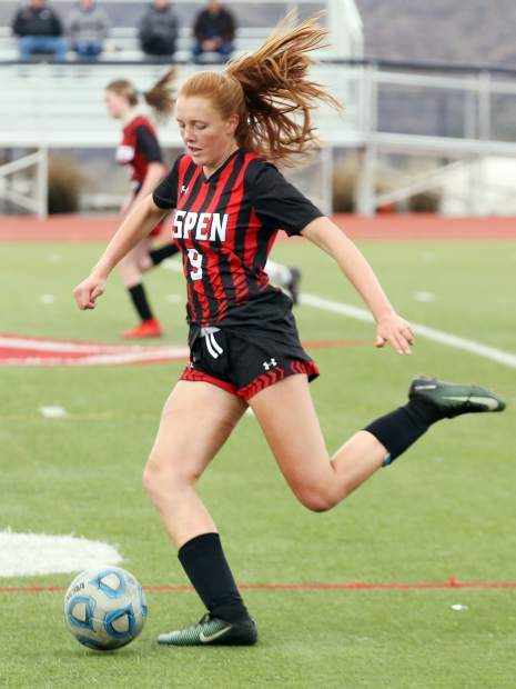 Aspen High School's Edie Sherlock winds up to kick in the girls soccer game against Coal Ridge on Tuesday, April 16, 2019, on the AHS turf. (photo by Austin Colbert/The Aspen Times).