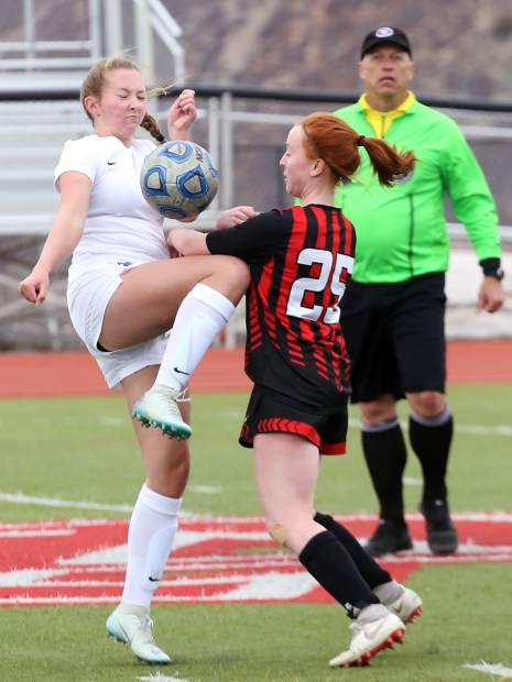 Aspen High School sophomore Kelley Francis, right, battles for the ball with Coal Ridge's Amanda McPherson in the girls soccer game on Tuesday, April 16, 2019, on the AHS turf. (photo by Austin Colbert/The Aspen Times).