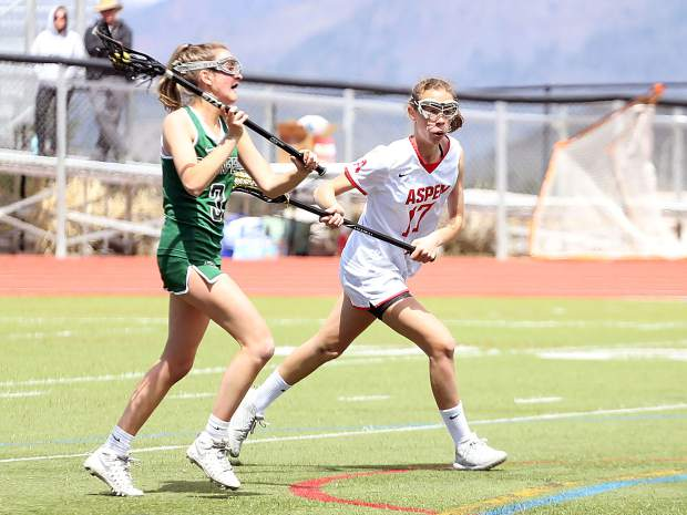 Aspen High School girls lacrosse plays in a game against Conifer on Saturday, April 20, 2019, on the AHS turf. (Photo by Austin Colbert/The Aspen Times)