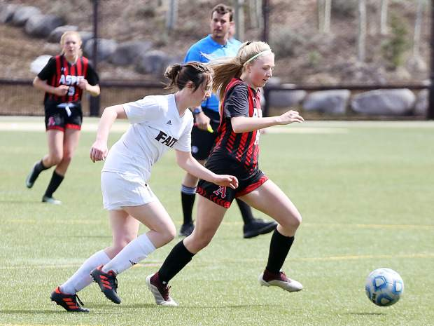 Aspen High School sophomore Eva McDonough moves the ball past midfield in their girls soccer game against Faith Christian on Saturday, April 20, 2019, at Iselin Field in Aspen. (Photo by Austin Colbert/The Aspen Times)