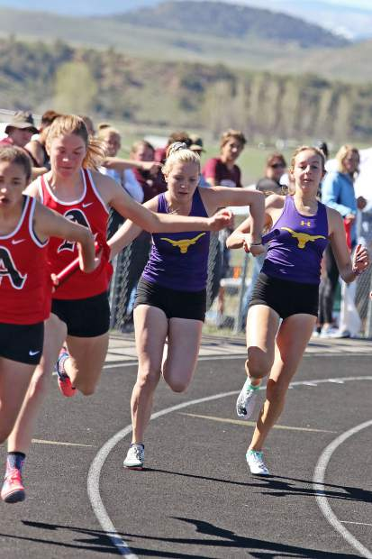 Teams compete in a relay during the Coal Ridge track meet on Friday.