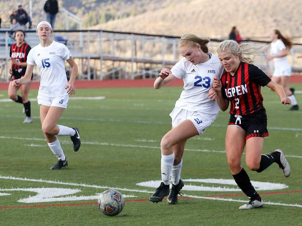 Aspen High School senior Ellie Oates, right, chases down the ball in the girls soccer game against Roaring Fork on Thursday, April 25, 2019, on the AHS turf. Aspen won, 3-1. (Photo by Austin Colbert/The Aspen Times).