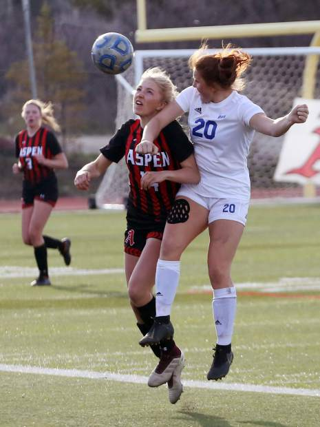 Aspen High School's Eva McDonough, left, battles for the ball in the girls soccer game against Roaring Fork on Thursday, April 25, 2019, on the AHS turf. Aspen won, 3-1. (Photo by Austin Colbert/The Aspen Times).