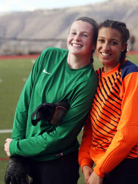 Aspen High School goalies Ella Trane, left, and Zulieka Hanson pose prior to the girls soccer game against Roaring Fork on Thursday, April 25, 2019, on the AHS turf. Aspen won, 3-1. (Photo by Austin Colbert/The Aspen Times).