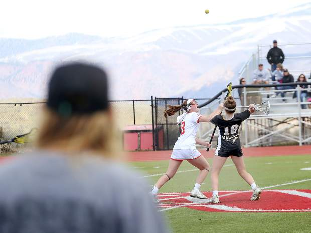 Aspen High School girls lacrosse coach Amanda Trendell watches as her team plays a game against Arapahoe on Saturday, April 27, 2019, on the AHS turf. (Photo by Austin Colbert/The Aspen Times).