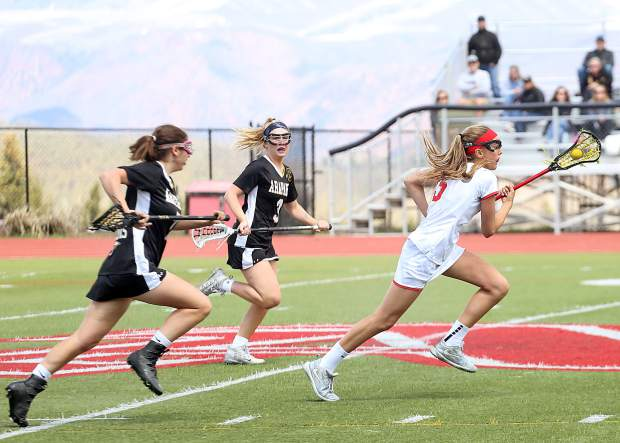 Aspen High School sophomore Kylie Kenny races upfield with the ball in the girls lacrosse game against Arapahoe on Saturday, April 27, 2019, on the AHS turf. (Photo by Austin Colbert/The Aspen Times).