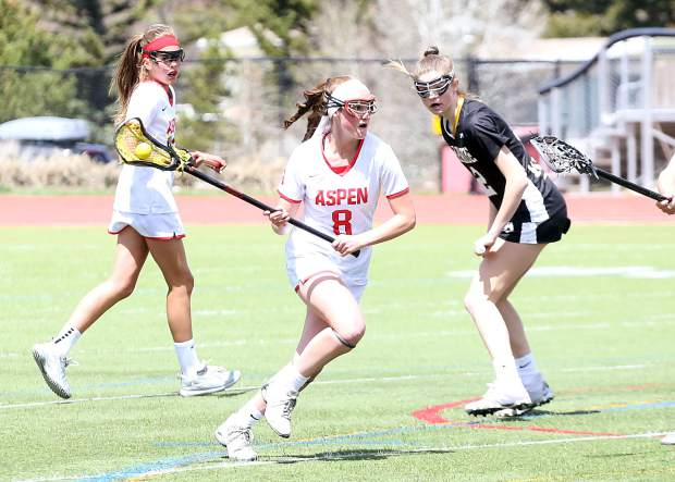 Aspen High School junior Charlotte Howie goes on the attack as the girls lacrosse team plays a game against Arapahoe on Saturday, April 27, 2019, on the AHS turf. (Photo by Austin Colbert/The Aspen Times).
