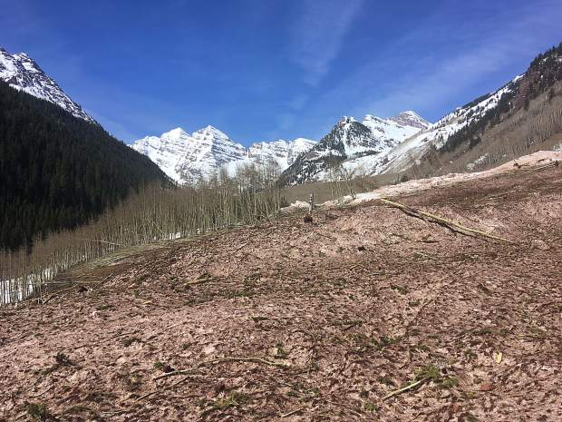 A debris pile covers Maroon Creek Road. The Aspen-Sopris Ranger District, in consultation with Pitkin County Road and Bridge Department, have determined the road won't be cleared by May 15.