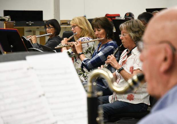 Members of Symphony in the Valley practice during an evening rehearsal at Glenwood Springs High School on Wednesday.