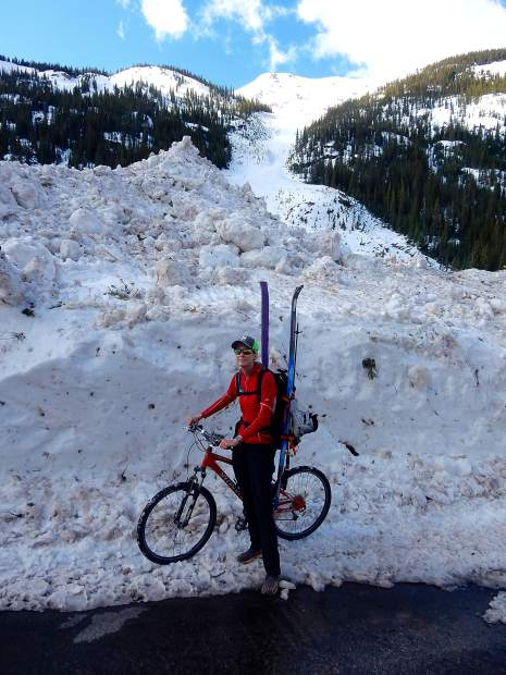 Karin Teague, executive director of the Independence Pass Foundation, stops to check conditions on Highway 82 Thursday in the debris flow of an avalanche from the top of Green Mountain that reached the road.