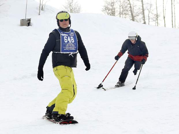 Instructor Paul Dowsett, left, and trainee George Kellogg take part in the National Disabled Veterans Winter Sports Clinic in Snowmass on Wednesday, April 3, 2019. (Photo by Austin Colbert).