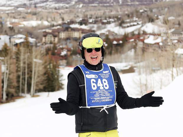 Instructor Paul Dowsett shares a laugh with trainee George Kellogg (not pictured) during the National Disabled Veterans Winter Sports Clinic in Snowmass on Wednesday, April 3, 2019. (Photo by Austin Colbert).