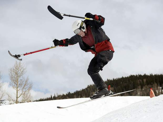 Texas native and Winter Park resident George Kellogg, a former Marine who is a one-legged skier, hits a jump while taking part in the National Disabled Veterans Winter Sports Clinic in Snowmass on Wednesday, April 3, 2019. (Photo by Austin Colbert).