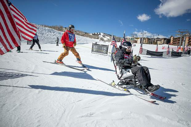 Robert Morrs skis down on the electric tetraski at the National Disabled Veterans winter sports clinic at Snowmass on April 1, 2019.