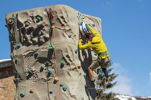 Craig DeMartino adjusts the auto-belay device on the rock climbing wall outside of the Westin in Snowmass on April 1 for the National Disabled Veterans winter sports clinic.