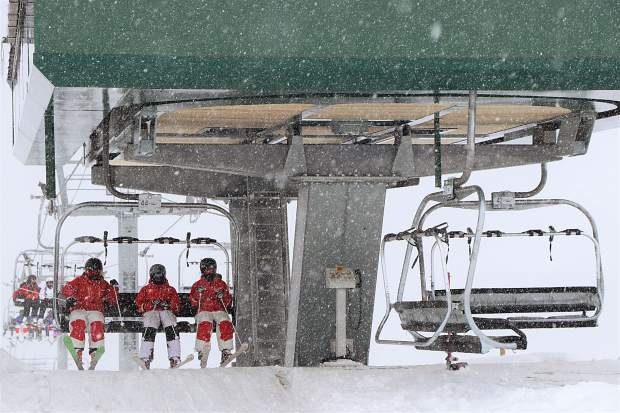 Skiers prepare to hop off a chairlift at Arapahoe Basin Ski Area on Tuesday morning in the midst of a May spring snow storm that dropped more than 6 inches of powder overnight Monday evening into Tuesday morning at the Summit County ski area at the Continental Divide.
