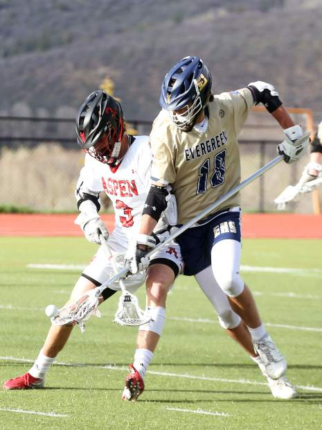 Aspen High School's Tyler Ward, left, battles for the ball in the boys lacrosse game against Evergreen in the first round of the 4A state playoffs on Tuesday, May 7, 2019, on the AHS turf. The Skiers lost, 10-5. (Photo by Austin Colbert/The Aspen Times)