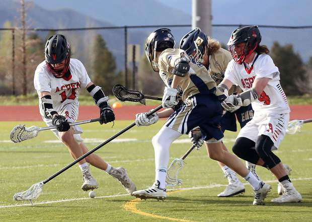 Players battle for a loose ball as the Aspen High School boys lacrosse team plays against Evergreen in the first round of the 4A state playoffs on Tuesday, May 7, 2019, on the AHS turf. The Skiers lost, 10-5. (Photo by Austin Colbert/The Aspen Times)
