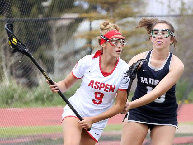 Aspen High School senior Sabrina Turbidy, left, goes on the attack in the girls lacrosse game against Air Academy on Saturday, May 11, 2019, on the AHS turf. (Photo by Austin Colbert/The Aspen Times)