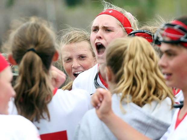 Aspen High School junior Hayley Heinecken celebrates in the postgame huddle after the AHS girls lacrosse team beat visiting Air Academy in the second round of the state playoffs on Saturday, May 11, 2019, on the AHS turf. The win advances the Skiers to the state quarterfinals for the first time in program history. Aspen will host Valor Christian on Wednesday for a spot in the semifinals. (Photo by Austin Colbert/The Aspen Times)