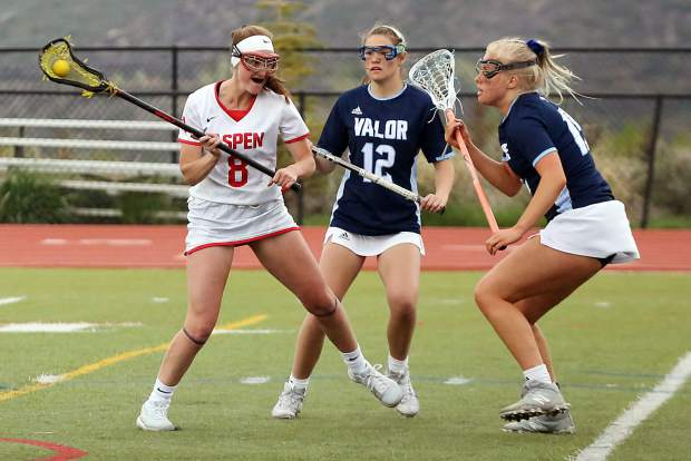 Aspen High School junior Charlotte Howie looks for a shot in the girls lacrosse game against Valor Christian in the state quarterfinals on Wednesday, May 15, 2019, on the AHS turf. (Photo by Austin Colbert/The Aspen Times)
