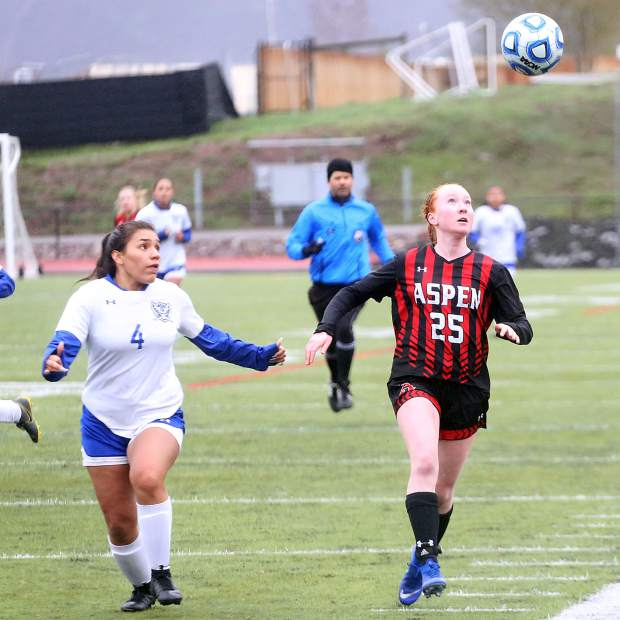 Aspen High School's Kelley Francis, right, tracks down a loose ball in the girls soccer game against Englewood on Wednesday, May 8, 2019, on the AHS turf. (Photo by Austin Colbert/The Aspen Times)