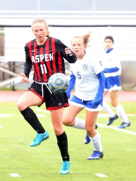 Aspen High School's Emily Brenninger corrals the ball in the girls soccer game against Englewood on Wednesday, May 8, 2019, on the AHS turf. (Photo by Austin Colbert/The Aspen Times)