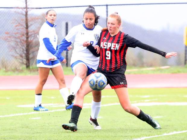 Aspen High School's Edie Sherlock, right, fights for the ball in the girls soccer game against Englewood on Wednesday, May 8, 2019, on the AHS turf. (Photo by Austin Colbert/The Aspen Times)